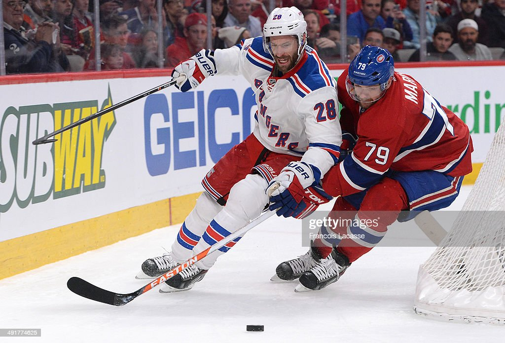 <a gi-track='captionPersonalityLinkClicked' href=/galleries/search?phrase=Andrei+Markov&family=editorial&specificpeople=204528 ng-click='$event.stopPropagation()'>Andrei Markov</a> #79 of the Montreal Canadiens fights for the puck against <a gi-track='captionPersonalityLinkClicked' href=/galleries/search?phrase=Dominic+Moore&family=editorial&specificpeople=223982 ng-click='$event.stopPropagation()'>Dominic Moore</a> #28 of the New York Rangers in Game One of the Eastern Conference Final during the 2014 Stanley Cup Playoffs at the Bell Centre on May 17, 2014 in Montreal, Quebec, Canada.