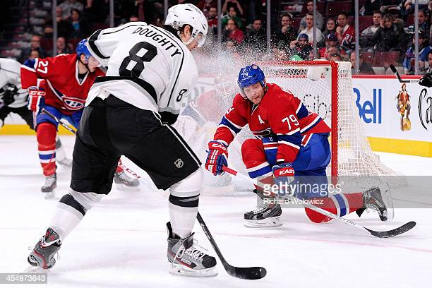 Andrei Markov of the Montreal Canadiens gets down to block a shot by Drew Doughty of the Los Angeles Kings during the NHL game at the Bell Centre on...