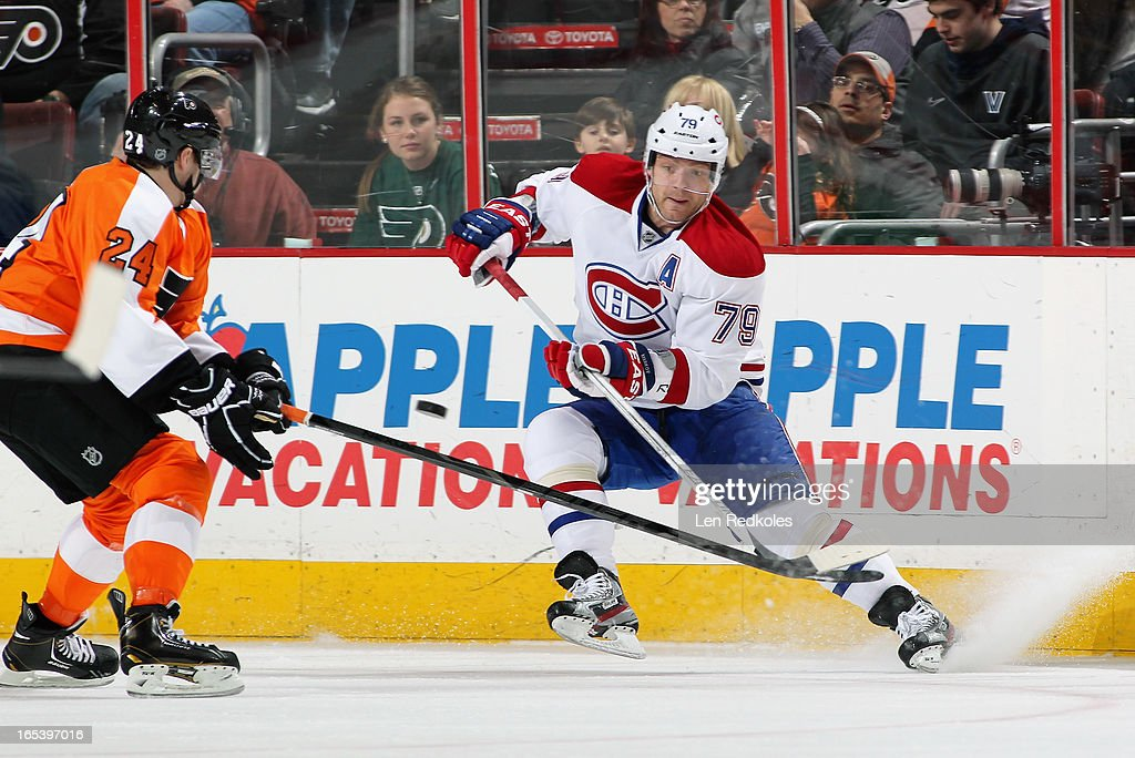 Andrei Markov #79 of the Montreal Canadiens makes a pass while being defended by <a gi-track='captionPersonalityLinkClicked' href=/galleries/search?phrase=Matt+Read&family=editorial&specificpeople=6783206 ng-click='$event.stopPropagation()'>Matt Read</a> #24 of the Philadelphia Flyers on April 3, 2013 at the Wells Fargo Center in Philadelphia, Pennsylvania.