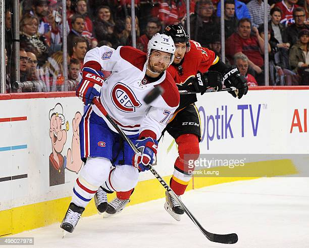 Andrei Markov of the Montreal Canadiens passes the puck before David Jones of the Calgary Flames can check him during an NHL game at Scotiabank...