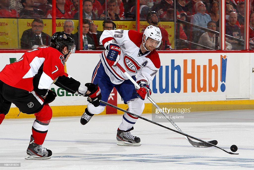 Andrei Markov #79 of the Montreal Canadiens passes the puck through Kyle Turris #7 of the Ottawa Senators in Game Three of the Eastern Conference Quarterfinals during the 2013 NHL Stanley Cup Playoffs at Scotiabank Place on May 5, 2013 in Ottawa, Ontario, Canada.