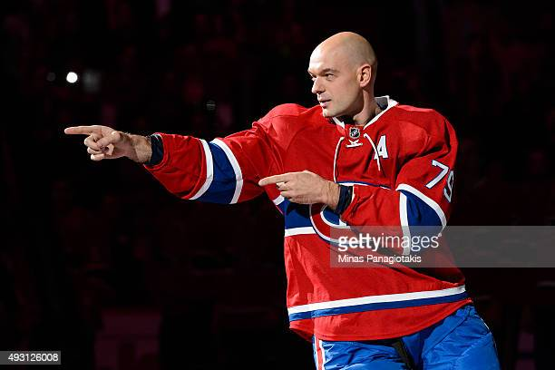 Andrei Markov of the Montreal Canadiens points towards teammate PK Subban during the pre game ceremony prior to the NHL match against the New York...