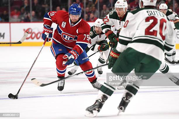 Andrei Markov of the Montreal Canadiens skates with the puck against of the Minnesota Wild in the NHL game at the Bell Centre on November 8 2014 in...