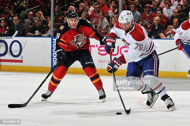 Andrei Markov of the Montreal Canadiens skates with the puck against Reilly Smith of the Florida Panthers at the BBT Center on December 29 2015 in...