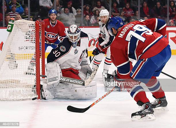 Andrei Markov of the Montreal Canadiens takes a shot on goal Curtis Mcelhinney of the Columbus Blue Jackets in the NHL game at the Bell Centre on...