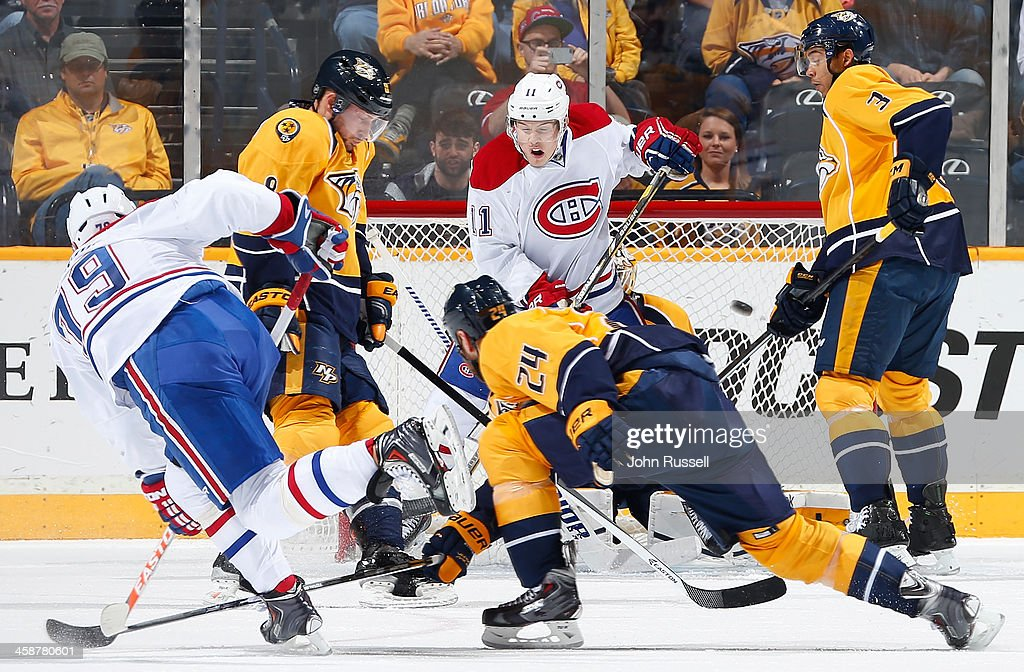 <a gi-track='captionPersonalityLinkClicked' href=/galleries/search?phrase=Andrei+Markov&family=editorial&specificpeople=204528 ng-click='$event.stopPropagation()'>Andrei Markov</a> #79 of the Montreal Canadiens takes a slapshot against the Nashville Predators at Bridgestone Arena on December 21, 2013 in Nashville, Tennessee.