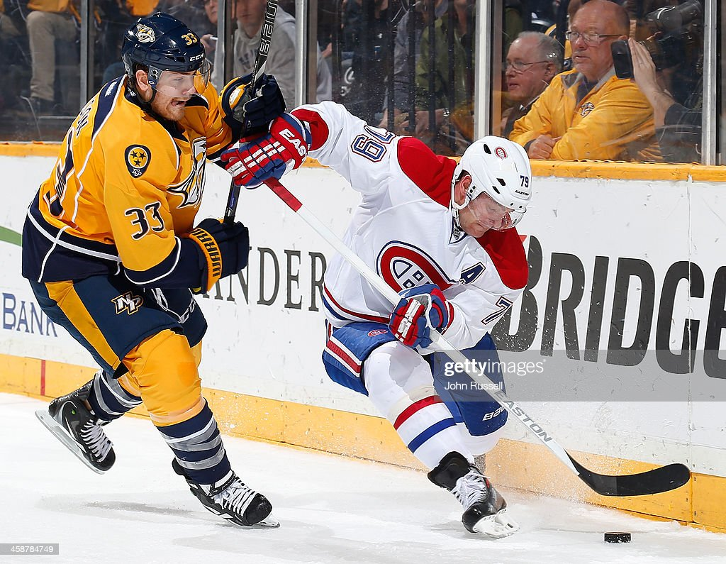 <a gi-track='captionPersonalityLinkClicked' href=/galleries/search?phrase=Andrei+Markov&family=editorial&specificpeople=204528 ng-click='$event.stopPropagation()'>Andrei Markov</a> #79 of the Montreal Canadiens works the puck behind the net against Colin Wilson #33 of the Nashville Predators at Bridgestone Arena on December 21, 2013 in Nashville, Tennessee.