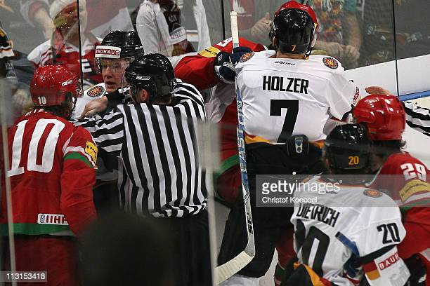 Andrei Mikhalyov of Belarus and Korbinian Holzer fight during the international friendly match between Germany and Belarus at Lanxess Arena on April...