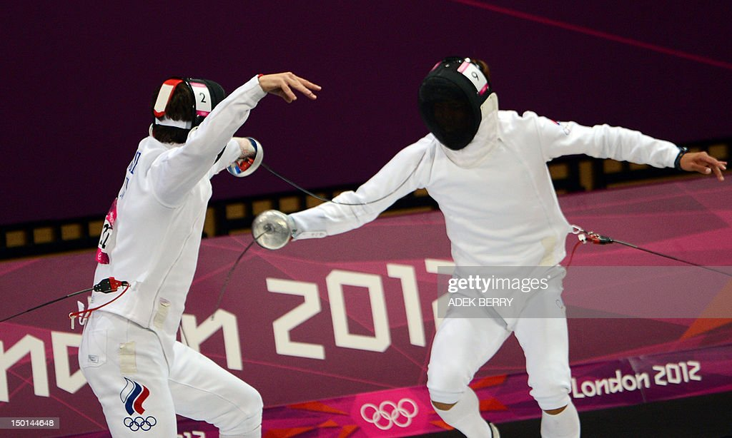Andrei Moiseev of Russia (L) competes against Jung Jinhwa of South Korea (R) during the fencing epee one touch part of the Modern Pentathlon at the London 2012 Olympic Games in London on August 11, 2012.