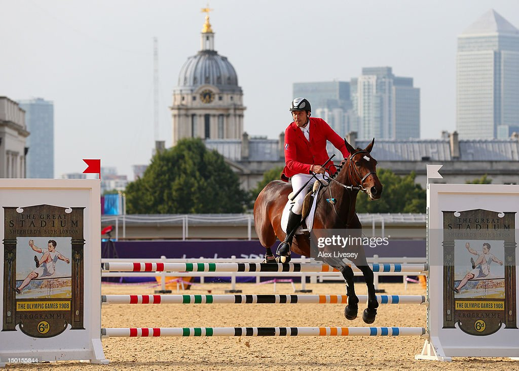 Andrei Moiseev of Russia riding Darcland competes in the Riding Show Jumping during the Men's Modern Pentathlon on Day 15 of the London 2012 Olympic Games on August 11, 2012 in London, England.
