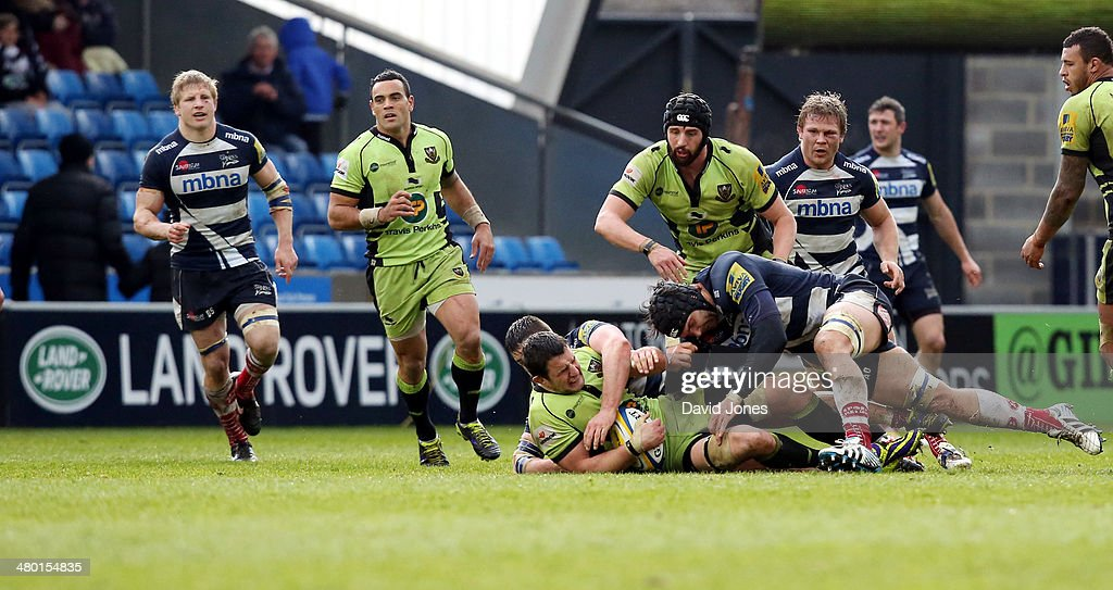 Andrei Ostrikov of Sale Sharks tackles Phil Dowson of Northampton Saints during the Aviva Premiership match between Sale Sharks and Northampton Saints at the A J Bell Stadium, on March 22, 2014 in Salford, England