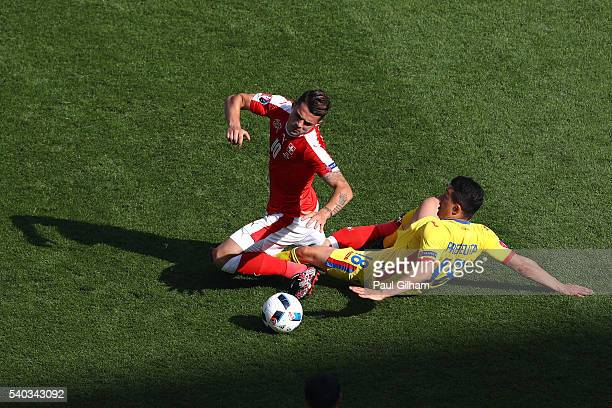 Andrei Prepelita of Romania makes a challenge on Granit Xhaka of Switzerland during the UEFA EURO 2016 Group A match between Romania and Switzerland...
