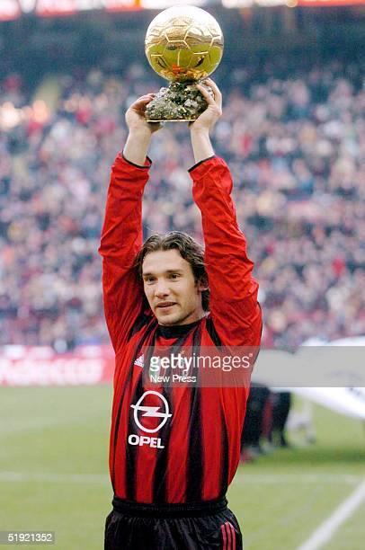 Andrei Shevchenko of AC Milan holds the trophy aloft after winning the European Golden Ball award 2004 before the Serie A Match between Milan and...