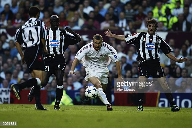 Andrei Shevchenko of AC Milan skips past Paolo Montero Lilian Thuram and Ciro Ferrara of Juventus during the UEFA Champions League Final match...