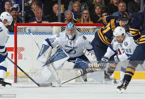 Andrei Vasilevskiy and Gabriel Dumont of the Tampa Bay Lightning defend against Evan Rodrigues of the Buffalo Sabres during an NHL game at the...