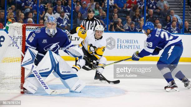 Andrei Vasilevskiy and Slater Koekkoek of the Tampa Bay Lightning skates against Jake Guentzel of the Pittsburgh Penguins during the second period at...
