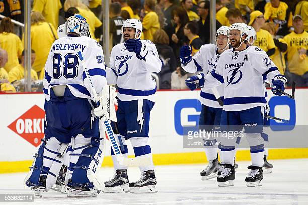 Andrei Vasilevskiy of the Tampa Bay Lightning celebrates with his teammates after defeating the Pittsburgh Penguins in overtime of Game Five of the...