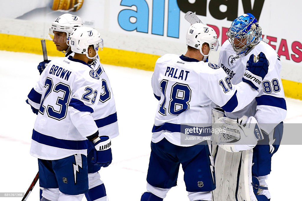 <a gi-track='captionPersonalityLinkClicked' href=/galleries/search?phrase=Andrei+Vasilevskiy+-+Ice+Hockey+Player&family=editorial&specificpeople=9594320 ng-click='$event.stopPropagation()'>Andrei Vasilevskiy</a> #88 of the Tampa Bay Lightning celebrates with teammate Ondrej Palat #18 after defeating the Pittsburgh Penguins in Game One of the Eastern Conference Final with a score of 3 to 1 during the 2016 NHL Stanley Cup Playoffs on May 13, 2016 in Pittsburgh, Pennsylvania.