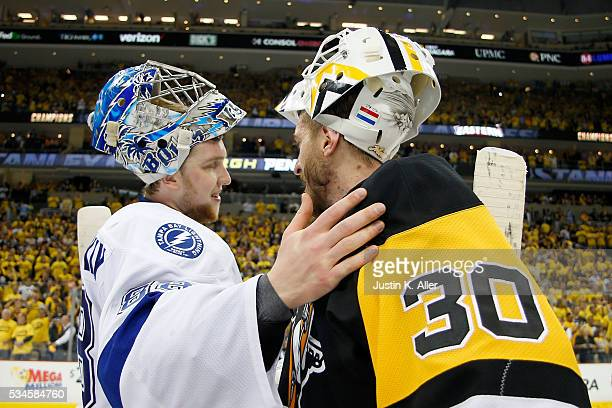 Andrei Vasilevskiy of the Tampa Bay Lightning congratulates Matt Murray of the Pittsburgh Penguins celebrate after defeating the Tampa Bay Lightning...