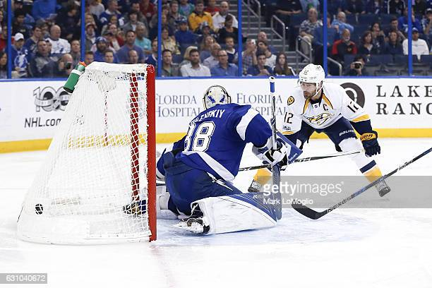 Andrei Vasilevskiy of the Tampa Bay Lightning gives up a goal to Mike Fisher of the Nashville Predators at Amalie Arena on January 5 2017 in Tampa...