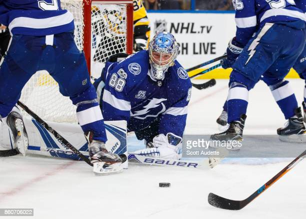 Andrei Vasilevskiy of the Tampa Bay Lightning looks for the puck against the Pittsburgh Penguins during the second period at Amalie Arena on October...