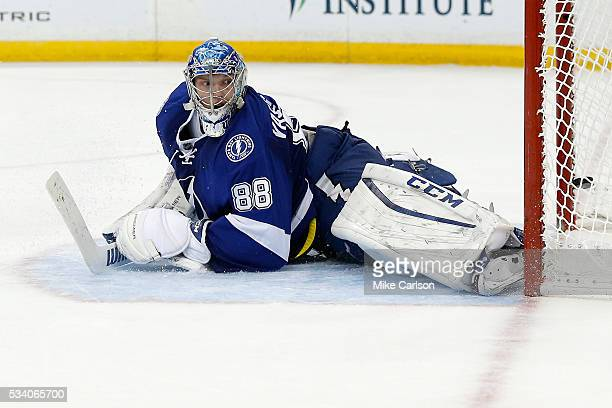 Andrei Vasilevskiy of the Tampa Bay Lightning looks on as he gives up a goal to Bryan Rust of the Pittsburgh Penguins during the third period in Game...