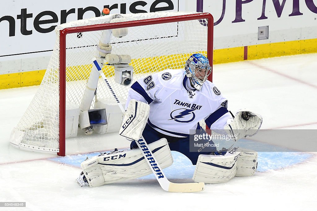 <a gi-track='captionPersonalityLinkClicked' href=/galleries/search?phrase=Andrei+Vasilevskiy+-+Ice+Hockey+Player&family=editorial&specificpeople=9594320 ng-click='$event.stopPropagation()'>Andrei Vasilevskiy</a> #88 of the Tampa Bay Lightning makes a glove save during the first period against the Pittsburgh Penguins in Game Seven of the Eastern Conference Final during the 2016 NHL Stanley Cup Playoffs at Consol Energy Center on May 26, 2016 in Pittsburgh, Pennsylvania.