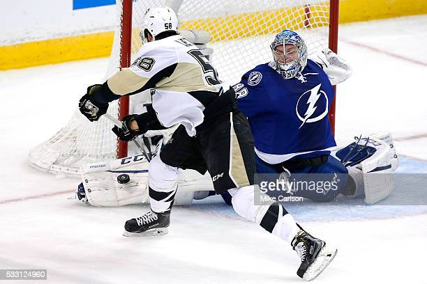 Andrei Vasilevskiy of the Tampa Bay Lightning makes a kick save against Kris Letang of the Pittsburgh Penguins during the first period in Game Four...