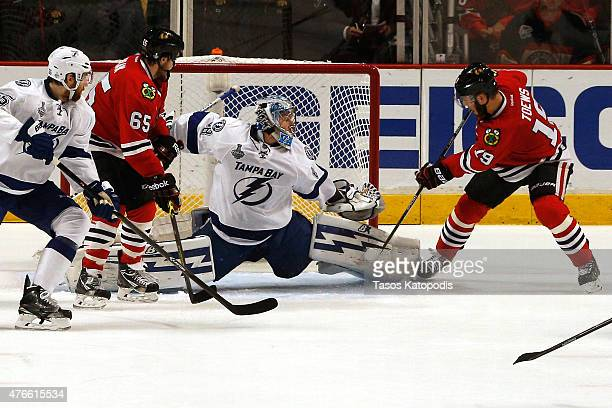 Andrei Vasilevskiy of the Tampa Bay Lightning makes a save against Jonathan Toews of the Chicago Blackhawks during Game Four of the 2015 NHL Stanley...