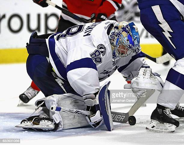 Andrei Vasilevskiy of the Tampa Bay Lightning makes a save against the Chicago Blackhawks at the United Center on January 24 2017 in Chicago Illinois...