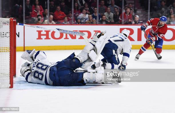 Andrei Vasilevskiy of the Tampa Bay Lightning makes a save in front of Alexander Radulov of the Montreal Canadiens in the NHL game at the Bell Centre...