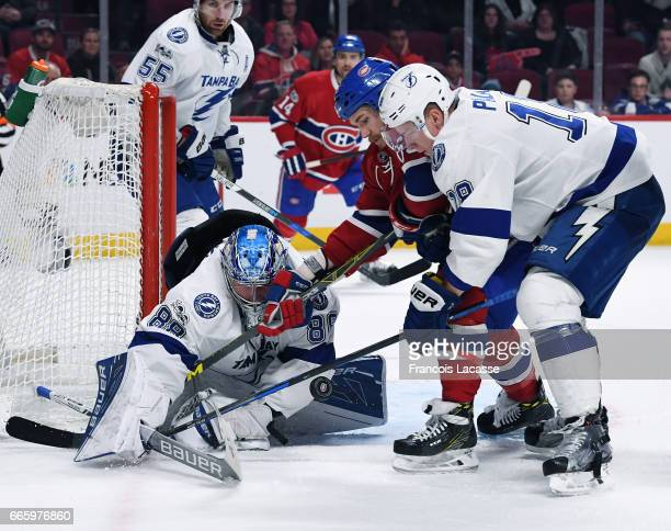 Andrei Vasilevskiy of the Tampa Bay Lightning makes a save in front of Andrew Shaw of the Montreal Canadiens in the NHL game at the Bell Centre on...