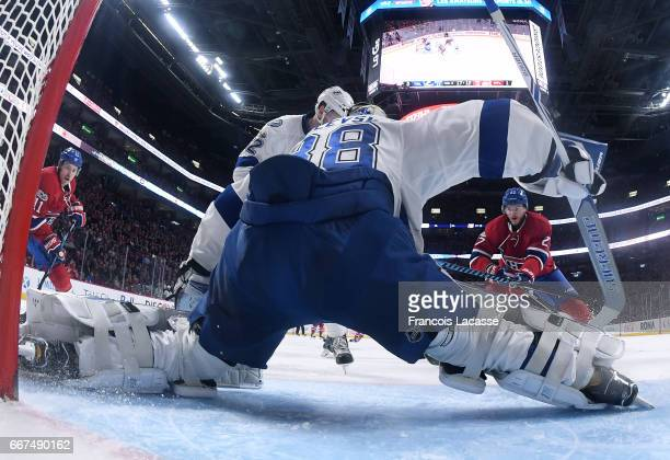 Andrei Vasilevskiy of the Tampa Bay Lightning protects the net against Alex Galchenyuk and Brendan Gallagher of the Montreal Canadiens in the NHL...