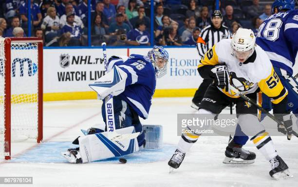 Andrei Vasilevskiy of the Tampa Bay Lightning skates against Jake Guentzel the Pittsburgh Penguins during the second period at Amalie Arena on...