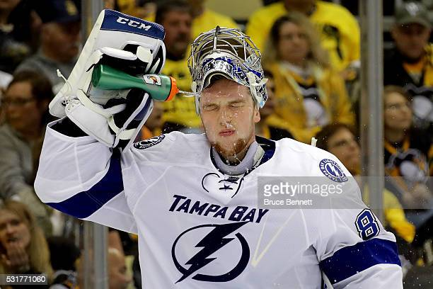Andrei Vasilevskiy of the Tampa Bay Lightning sprays water on his face during a break in the second period against the Pittsburgh Penguins in Game...