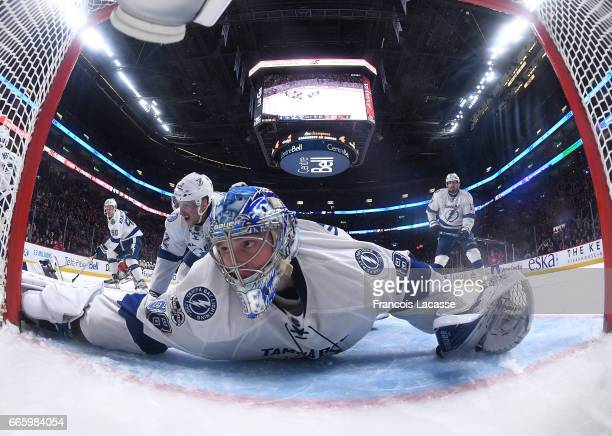 Andrei Vasilevskiy of the Tampa Bay Lightning stops a shot by the Montreal Canadiens in the NHL game at the Bell Centre on April 7 2017 in Montreal...