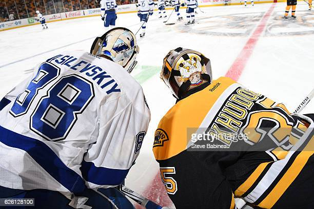 Andrei Vasilevskiy the Tampa Bay Lightning chats during warm ups with Anton Khudobin of the Boston Bruins at the TD Garden on November 27 2016 in...