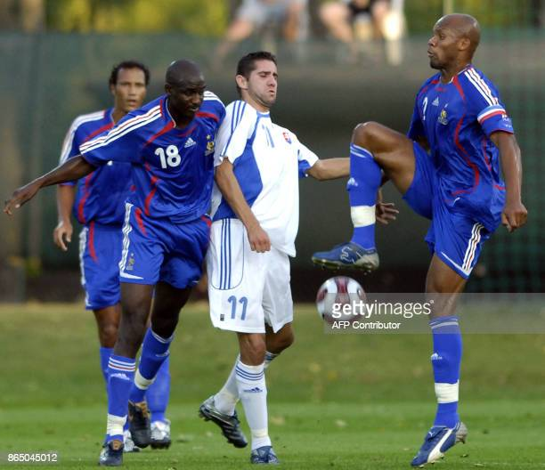 Andrej Hesek of Slovakia fights for the ball with Jean Alain Boumsong and teammate Alou Diarra 21 August 2007 during a U21 friendly soccer match...