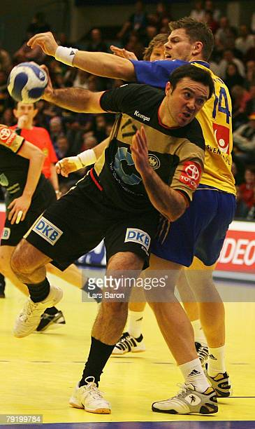 Andrej Klimovets of Germany in action with Robert Arrhenius of Sweden during the Men's Handball European Championship main round Group II match...