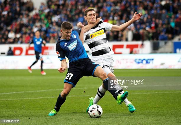Andrej Kramaric of 1899 Hoffenheim is challenged by Andreas Christensen of Borussia Moenchengladbach during the Bundesliga match between TSG 1899...