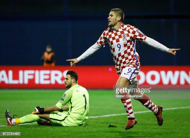 Andrej Kramaric of Croatia celebrates scoring a goal near goalkeeper Orestis Karnezis of Greece during the FIFA 2018 World Cup Qualifier PlayOff...