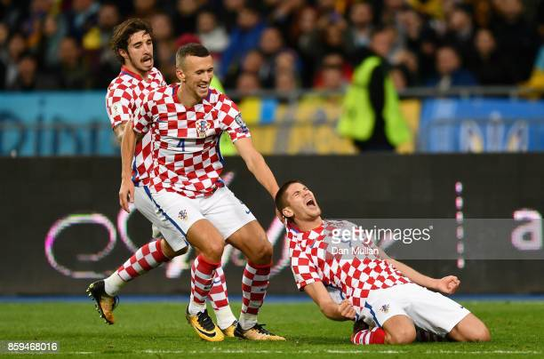 Andrej Kramaric of Croatia celebrates with Ivan Perisic of Croatia as he scores their first goal during the FIFA 2018 World Cup Group I Qualifier...