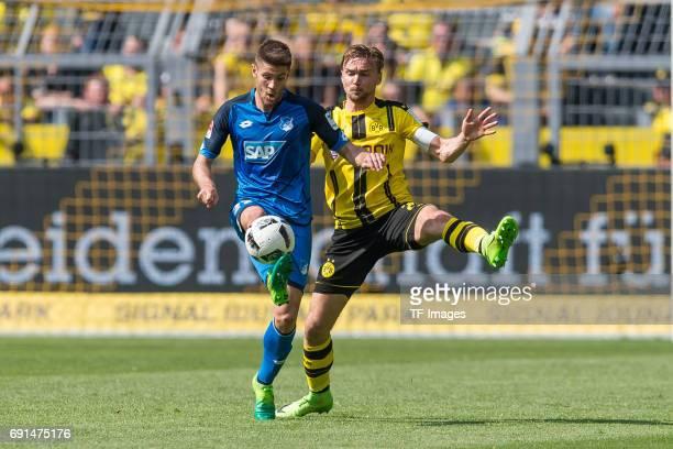 Andrej Kramaric of Hoffenheim and Marcel Schmelzer of Dortmund battle for the ball during the Bundesliga match between Borussia Dortmund and TSG 1899...