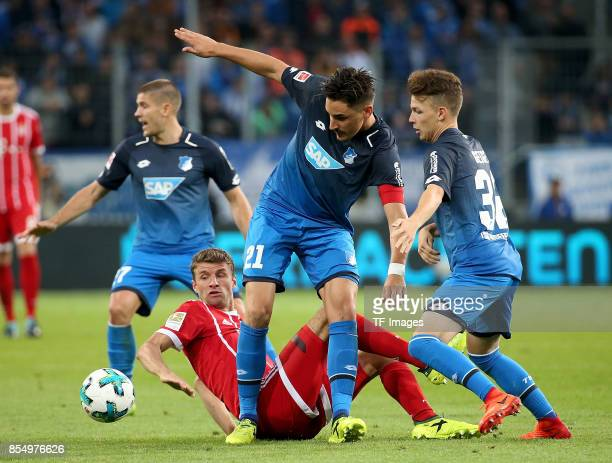 Andrej Kramaric of Hoffenheim and Thomas Müller of Muenchen and Benjamin Hübner of Hoffenheim and Dennis Geiger of Hoffenheim battle for the ball...