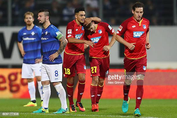 Andrej Kramaric of Hoffenheim celebrates his team's first goal with team mates Nadiem Amiri and Sebastian Rudy during the Bundesliga match between SV...