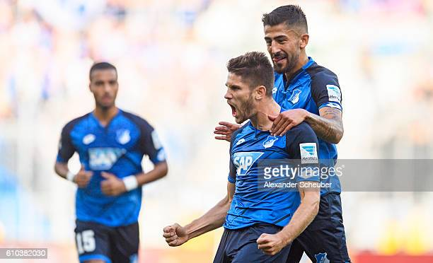 Andrej Kramaric of Hoffenheim celebrates the first goal for his team with Kerem Demirbay of Hoffenheim during the Bundesliga match between TSG 1899...