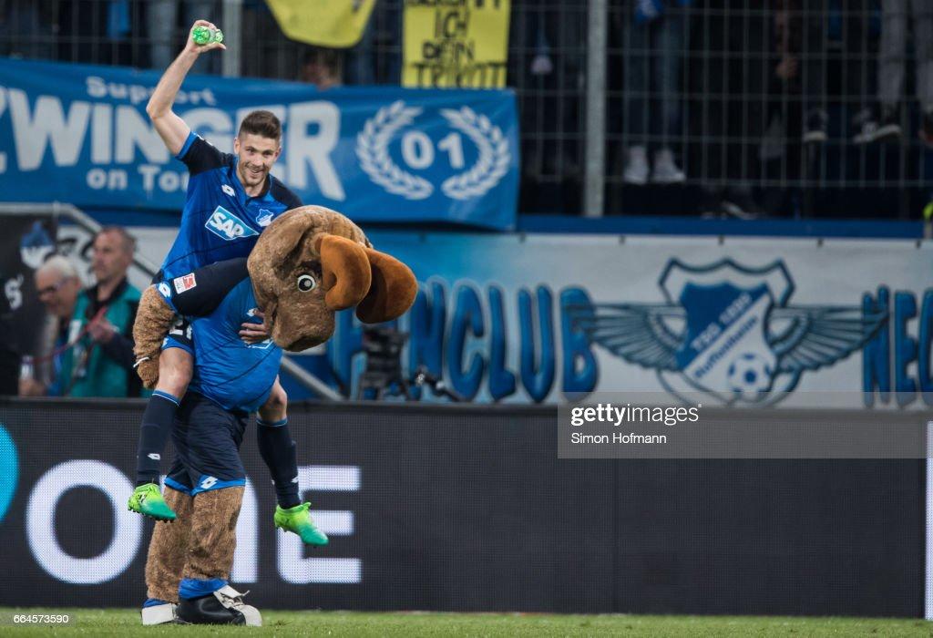 Andrej Kramaric of Hoffenheim celebrates winning with mascot Hoffi after the Bundesliga match between TSG 1899 Hoffenheim and Bayern Muenchen at Wirsol Rhein-Neckar-Arena on April 4, 2017 in Sinsheim, Germany.