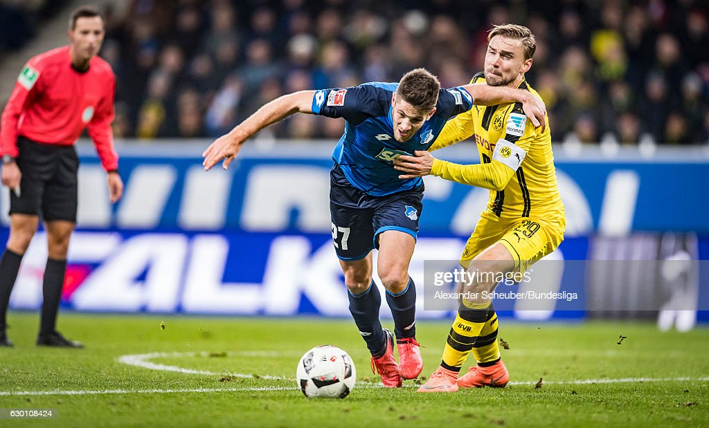 Andrej Kramaric of Hoffenheim challenges Marcel Schmelzer of Dortmund during the Bundesliga match between TSG 1899 Hoffenheim and Borussia Dortmund at Wirsol Rhein-Neckar-Arena on December 16, 2016 in Sinsheim, Germany.