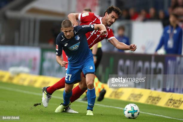 Andrej Kramaric of Hoffenheim fights for the ball with Mats Hummels of Bayern Muenchen during the Bundesliga match between TSG 1899 Hoffenheim and FC...