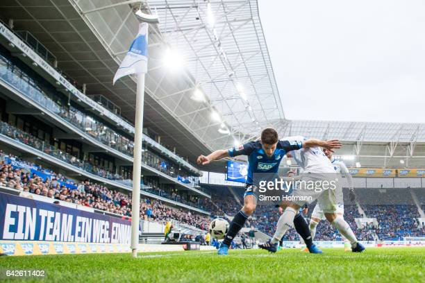 Andrej Kramaric of Hoffenheim is challenged by Fabian Holland of Darmstadt during the Bundesliga match between TSG 1899 Hoffenheim and SV Darmstadt...